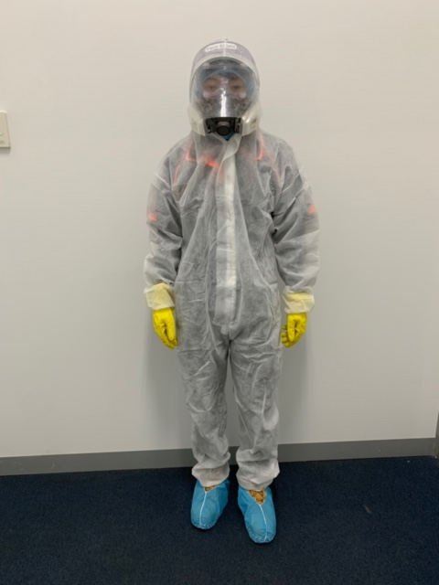 Clean Force team member dressed in full PPE gear fogging onsite